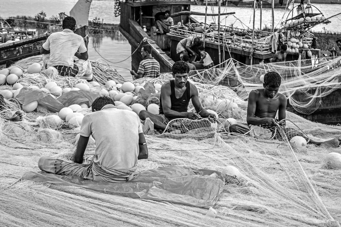 Fisherman making new nets