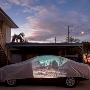 A projection of a boy on a swing on a playground erected by NGO 'Right to Play' in the refugee camp of Mae La on the Thai Burma Border. This image has been projected onto a driveway in Brisbane, Australia where a refugee family now resides. BRISBANE, AUSTRALIA - July 2015.