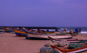 Pondycherry, India- December 2016. Fishing boats and nets in the Serenity beach.