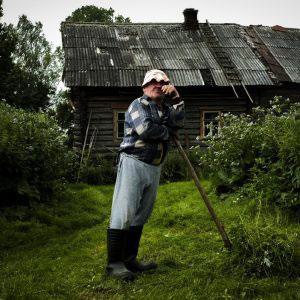 Farmer Chernov in front of his barn. Assorino Village. Kostroma region. July, 2016