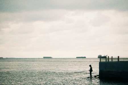 Jakarta, Indonesia - April 2017. Fishing, between me and fish there is come the sea