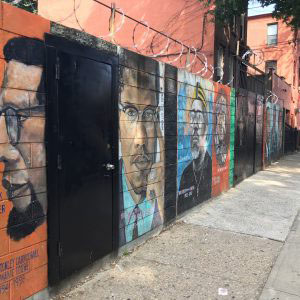 BROOKLYN, NEW YORK – SEPT 2017 After Bob, the portraits appear in this order: Stokely Carmichael, Malcolm X, the Honorable Robert Carson, Dr. Betty Shabazz, Martin Luther King Jr., Nelson Mandela, and Angela Davis—all are uniformly painted by the same hand.