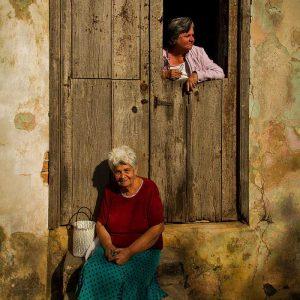 San Antonio de los Baños, Cuba - march 2013. Residents talking in the door in a ordinary evening of winter