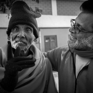 Joseph Dass with an 80 year old inmate. Kolkata, India, 2014