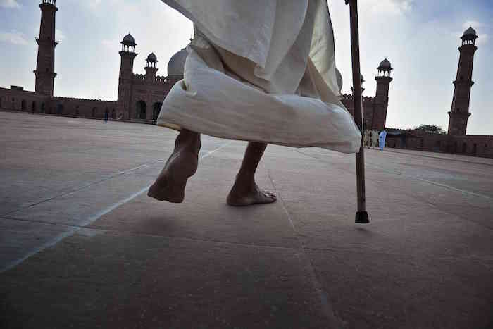 © Ed Kashi/VII Photo, Worshippers congregate in the courtyard during Friday prayers at the Badshahi Mosque in Lahore on Sept. 11, 2009.