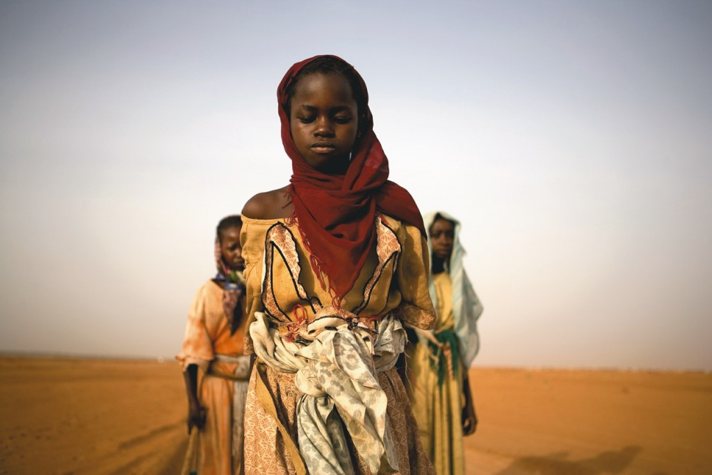 © Ron Haviv/VII Photo, Young Darfuri girls leave their displacement camp at sunrise to look for firewood to cook food for their families. The journey can take up to 3 days and will expose the girls to attack from the Janjaweed militia as well as the regular Sudanese armed forces. North Darfur 2005.