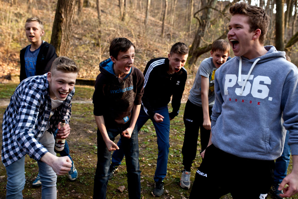 Reszel, Poland - April, 2015. Local youth in hanging out in Reszel Parks, many of whom are looking to move away.