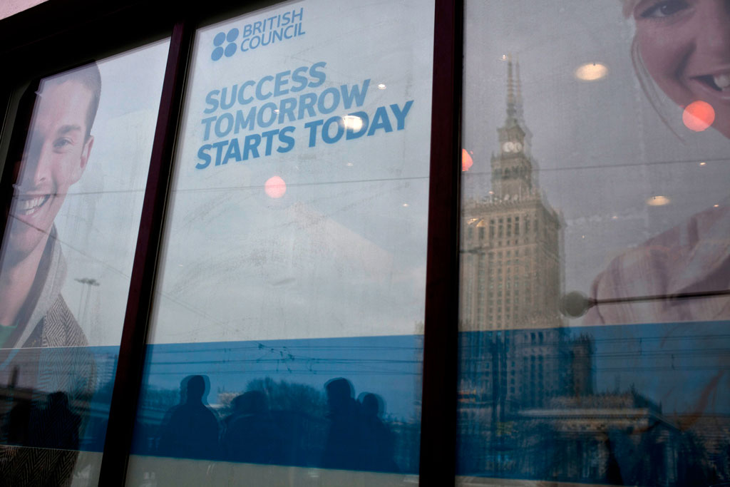 Warsaw, Poland - February, 2015. Warsaw's central tower that was built by Stalin 'as a gift'; in the reflection on the British Council office.