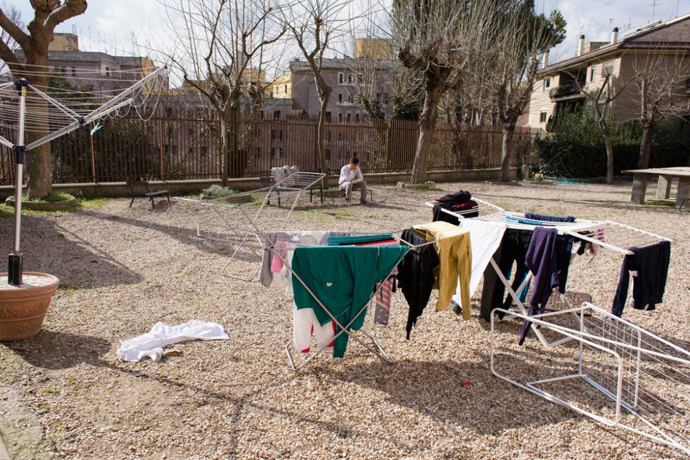 02/14/2015 - Rome (Italy). Fabio Massimo is 17 years old, he talks on a cell phone in the centre's garden.