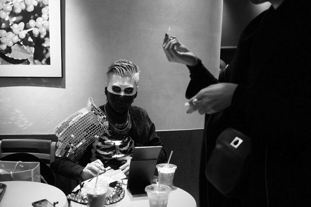 TOKYO, JAPAN - October 2015. Young man prepares his Halloween costume in restaurant.
