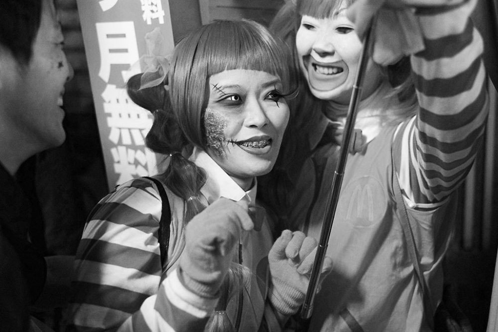TOKYO, JAPAN - October 2015. Friends dressed as zombie Ronald McDonalds.