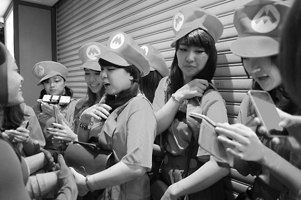TOKYO, JAPAN - October 2015. Halloween street party girls dressed as Mario Bros.