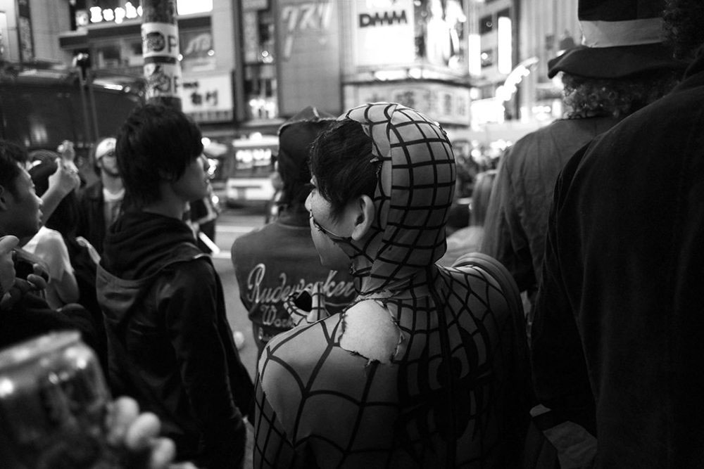 TOKYO, JAPAN - October 2015. Boy dressed as tattered Spiderman.