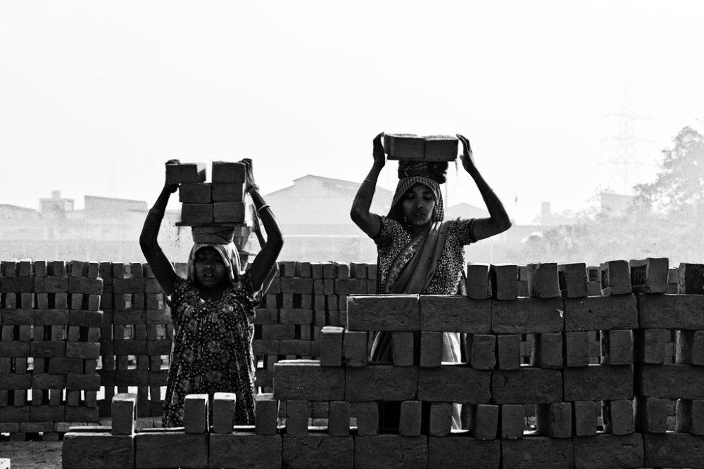 Kolkata, India- February 2016. Transferring the bricks toward the kiln.
