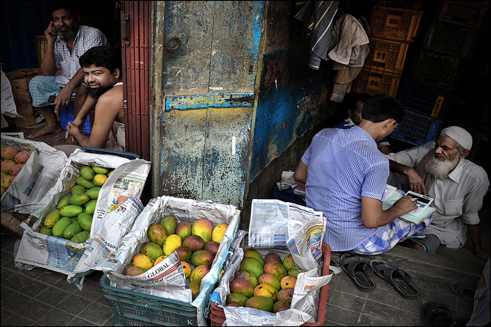 April-May 2015, Kolkata : Accounting part of the trade: A shop display mango boxes for selling in the retail market. Whole sale Mechua Bazar, the biggest fruit market in West Bengal. Daily transaction, score up to corers of Rupees