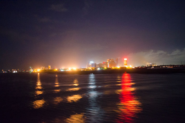 On the river Meghna,Bangladesh.June/2016.-Lights from cement industry and waves