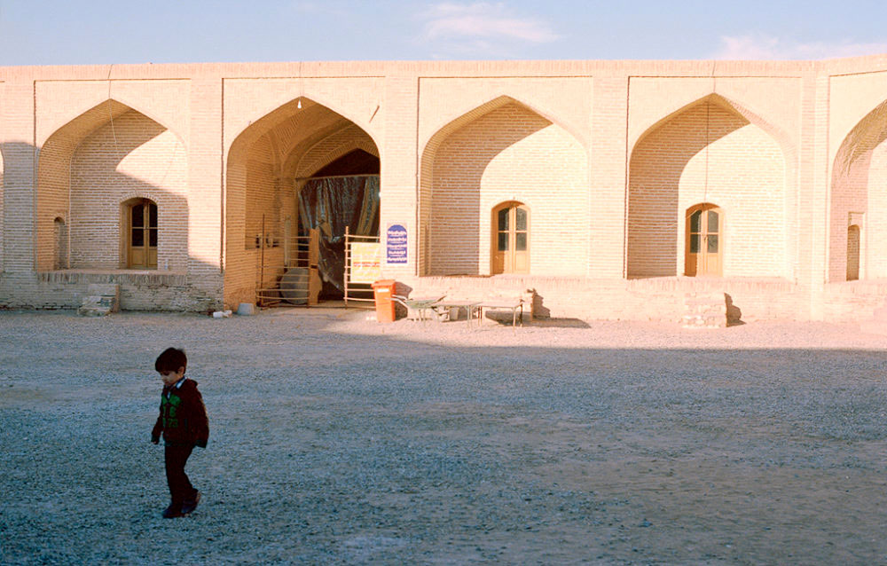Kid in the yard of Karvansaray in Maranjab desert, Kashan, Iran, November 2015
