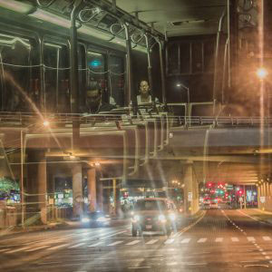 Honolulu, Hawaii - August, 2016. After 9 pm the whole city become calm and quiet. People usually are don't seen in the streets, the buses usually remain empty. I manage to relate these two cases and combine to a glass reflection on the bus.