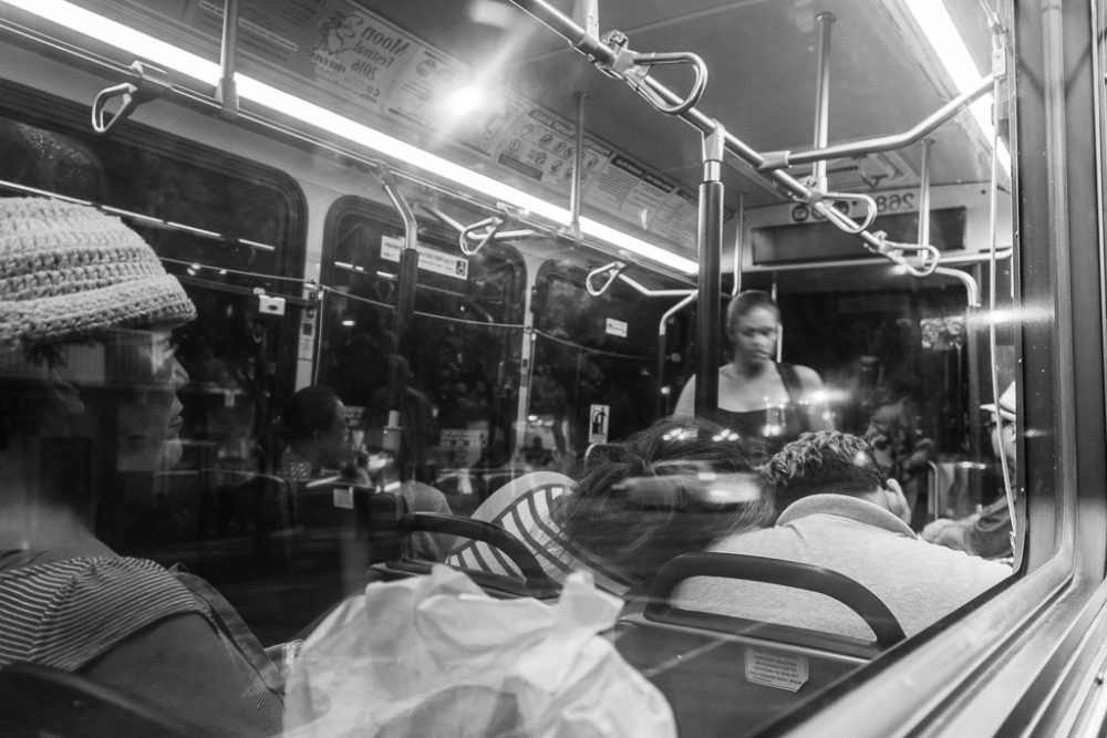 Honolulu, Hawaii - August, 2016. The most common scenario in the public bus is sleep. Sometimes they lean on the person whom they even don't know! In this case, I caught the reflection of a couple who was sleeping, leaning on each other with a touch of caring and love.