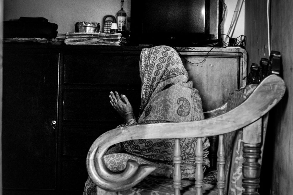 6. DHAKA, BANGLADESH - April 2016. My mom, a pious woman. Praying in her room alone. She had very fewer options to survive as a single mother in a society like ours where Islamic prejudices are dominant.