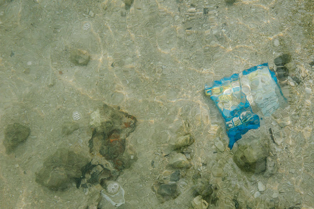 JAKARTA, INDONESIA - SEPTEMBER 03 : A plastic packaging buried on the ocean floor, on Thousand Islands, Jakarta, in Indonesia, 03 September 2016.