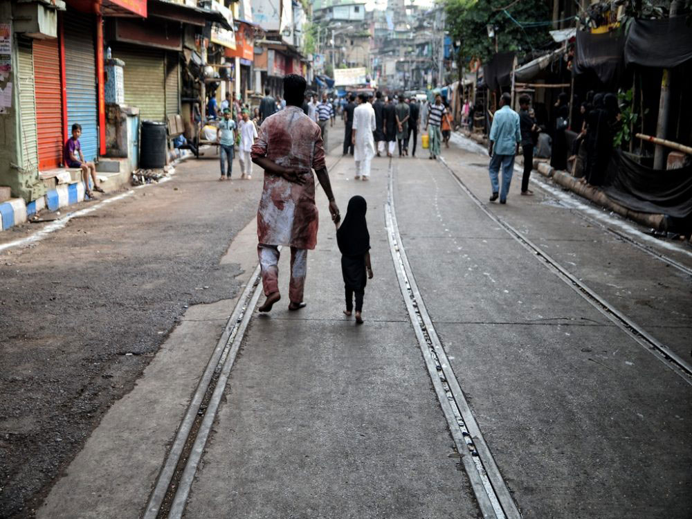 Father and daughter - both participants of the Muharram procession; Kolkata, India - Oct 2016