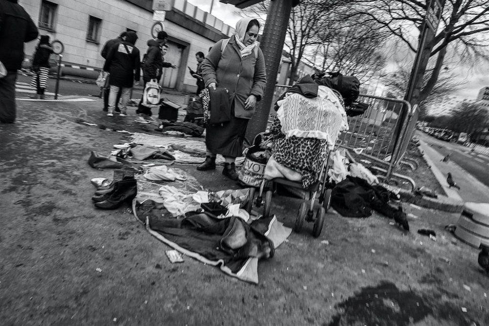 An elderly lady sells her goods