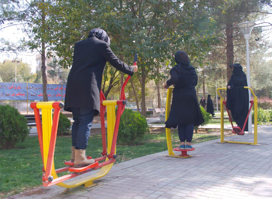 Tehran, Iran - November 2016. Women are doing exercises in the park.