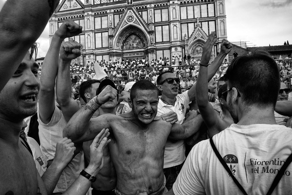 "Florence, Italy - June 2016; the Bianchi (""Whites"") di Santo Spirito celebrate after having defeated the opponent team of the Verdi (""Greens"")."