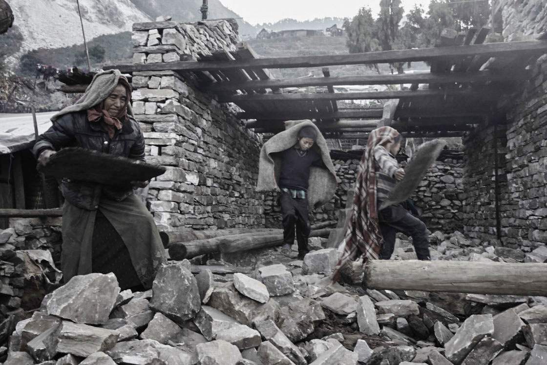 Villagers rebuilding their home in the remote village of Kerauja in Gorkha district.