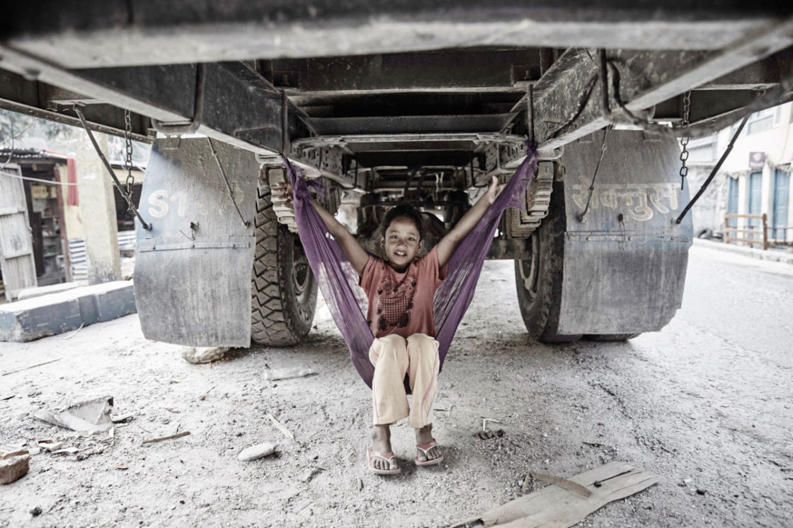 Earthquake survivor living in a truck together with her family.