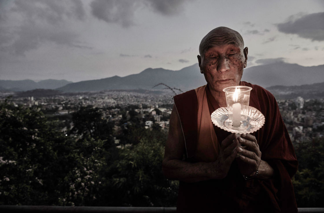 Buddhist monk praying for the deceased and survivors of the earthquakes.