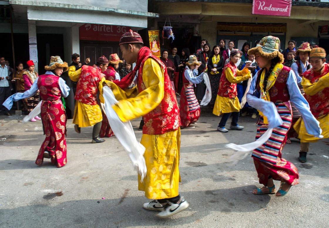 "Sikkim, India- December 2015. Group of traditionally dressed ""Bhutia"" performer is celebrating ""Lawsung"" by Dancing and Singing in front of Rumtek Monastery. Lawsung is a five day's festival to offering thanks to God for good harvest, as well as this is the festival to welcome Tibetan upcoming year."