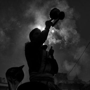 Varanasi, India-January, 2015. A priest is worshiping the river Ganges at Varanasi