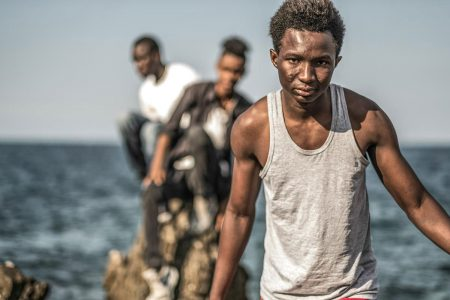Mondello - Italy - October 2016 - migrants on the rocks