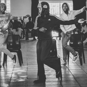 Paarl, Western Cape, SA - July 2017. Impromptu dance routines choreographed to local kwaito hits are met with loud applause in the talent show. Kwaito, which originated out of the townships of Gauteng in the '90s, is a mix of house rhythms, percussive synth loops, African instrumentals, and distinctive vocals; its genre-bending sonic texture has successfully brought township culture into the post-Apartheid South African mainstream, and its popularity continues to endure.