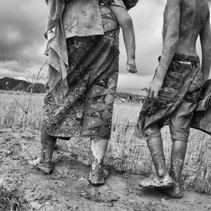 01 September 2017 – Teknuf, Bangladesh- A Rohingya family make their way through muddy field after arriving on a boat and cross to Naf river from Bangladesh-Myanmar border. © Monirul Alam / WITNESS PHOTO