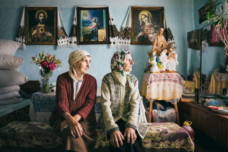 Kosiv, Ukraine - June 2017. Ganusia and Nastia, two sisters in the living room of Nastia