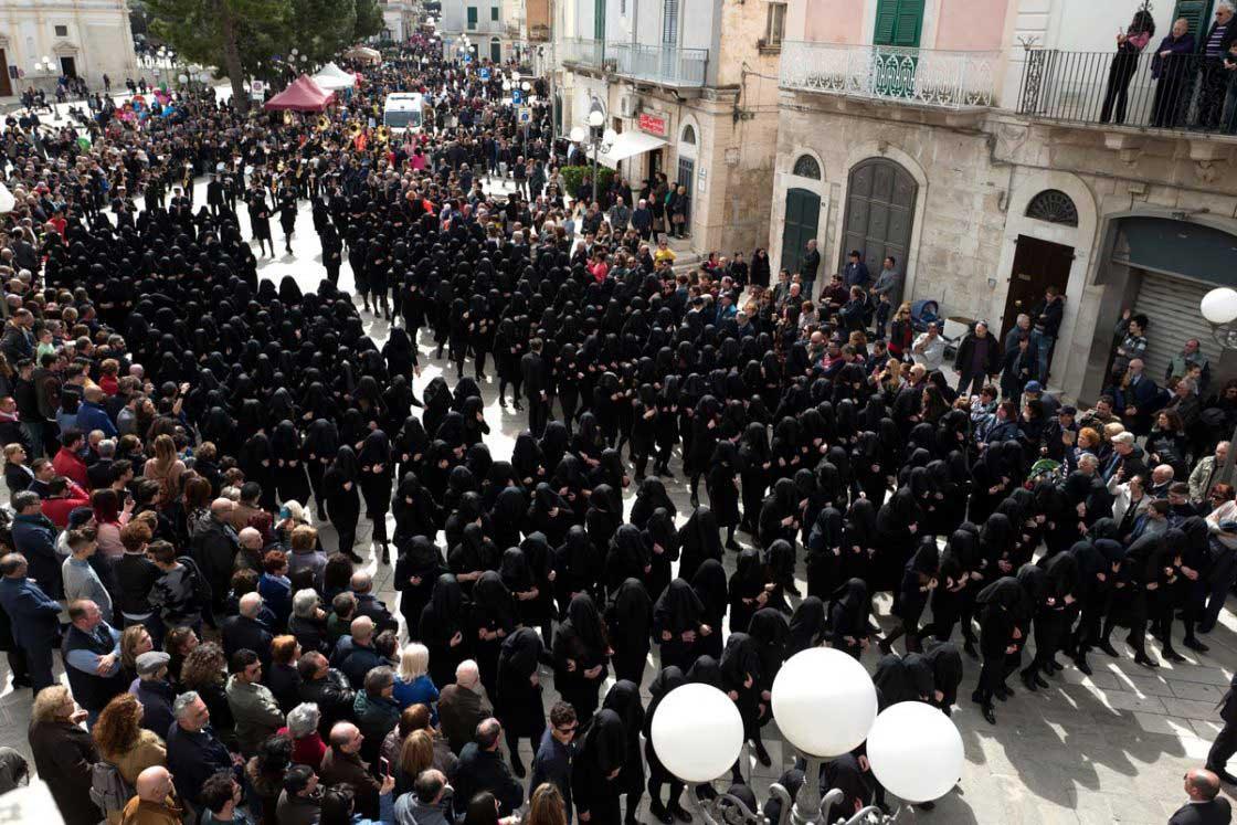 Top view of the female choir walking through the main road of the Canosa di Puglia's village, Corso San Sabino.